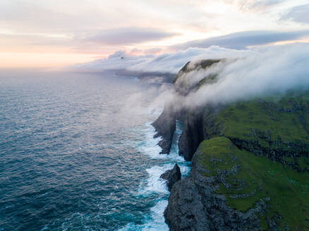 Scenic aerial view of a cliff on North Atlantic sea during the sunset, Faroe island. - AAEF02959