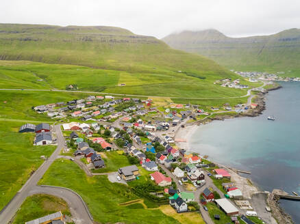 Aerial view of small city on the shore of north Atlantic sea, Faroe island - AAEF02962