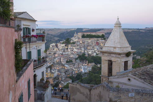 View over Ragusa Ibla, dusk, bell-tower of the Church of Santa Maria delle Scale in foreground, Ragusa, UNESCO World Heritage Site, Sicily, Italy, Europe - RHPLF00595