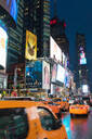Yellow taxis in Times Square at night. New York City, New York, United States of America, North America - RHPLF00734