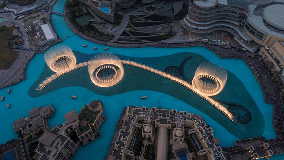 Aerial view of the illuminated Dubai fountain at night in United Arab Emirates - AAEF03256