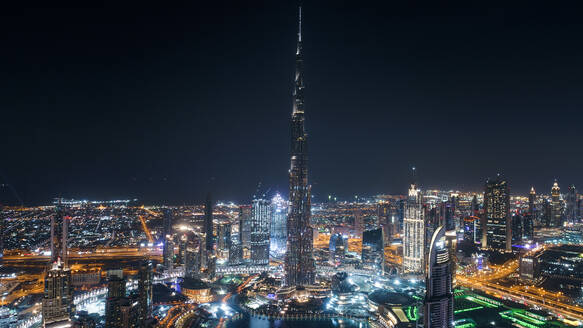 Aerial view of Burj Khalifa tower illuminated at night in Dubai, United Arab Emirates. - AAEF03322