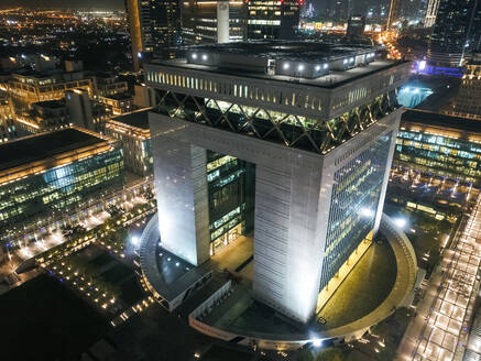 Aerial view of The Dubai International Finance Center at night, United Arab Emirates. - AAEF03334