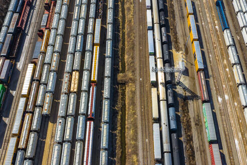Aerial view of rail cars waiting at a staging railyard station in Aurora, IL - USA - AAEF03406
