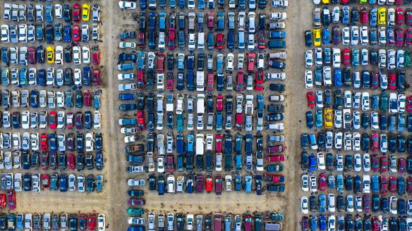 Aerial view of rows of old cars that have served, assembled in a junk yard waiting to be recycled for their reusable parts, Aurora, IL, USA - AAEF03424