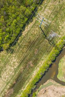 Aerial view of a high voltage electricity power lines and network in Aurora, IL, United States - AAEF03487