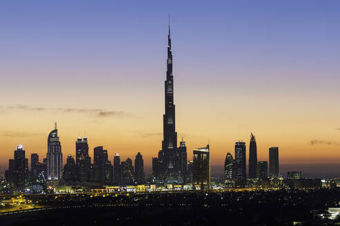 Elevated view of the new Dubai skyline, the Burj Khalifa, modern architecture and skyscrapers on Sheikh Zayed Road, Dubai, United Arab Emirates, Middle East - RHPLF01090