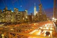 Manhattan skyline from the Brooklyn Bridge at night, New York, United States of America, North America - RHPLF01111