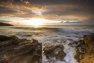 The last sunbeams on the cliffs and sea around Galley Bay, St. John's, Antigua, Antigua and Barbuda, Leeward Islands, West Indies, Caribbean, Central America - RHPLF01192