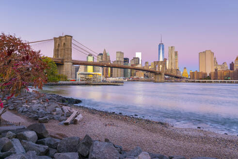Brooklyn Bridge over East River, Lower Manhattan skyline, including Freedom Tower of World Trade Center, New York, United States of America, North America - RHPLF01321