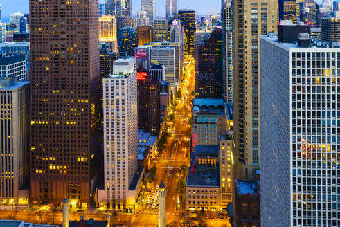 Chicago skyscrapers and North Michigan Avenue at dusk, Chicago, Illinois, United States of America, North America - RHPLF01471