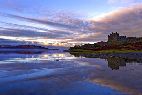 Early morning view of Castle Tioram and Loch Moidart as dawn breaks in a warm colorful sky to form attractive reflections, Highlands, Scotland, United Kingdom, Europe - RHPLF01483