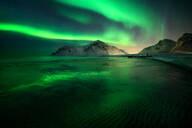 Aurora Borealis (Northern Lights) above Flakstad Beach, Lofoten Islands, Nordland, Norway, Europe - RHPLF01681