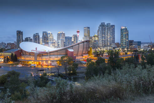 View of the Saddledome and Downtown skyline from Scottsman Hill at dusk, Calgary, Alberta, Canada, North America - RHPLF02390