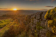 View of sunset from dry stone wall on Baslow Edge, Baslow, Peak District National Park, Derbyshire, England, United Kingdom, Europe - RHPLF02843