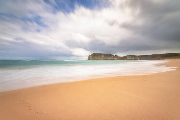 Scenic view of beach against cloudy sky at Twelve Apostles Marine National Park, Victoria, Australia - SMAF01305