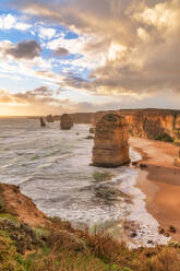 Stack rocks in sea against cloudy sky at Twelve Apostles Marine National Park, Victoria, Australia - SMAF01311