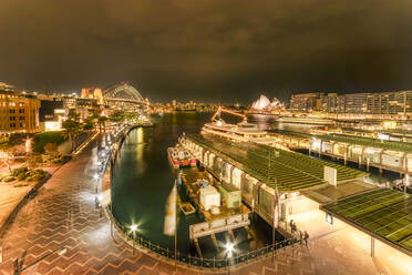 Illuminated Circular Quay at night in Sydney, Australia - SMAF01329