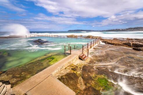 North Curl Curl Rockpool at beach against sky, Sydney, Australia - SMAF01332