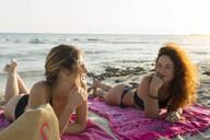 Son Bou beach, Menorca, Spain. Summer time. Two friends at the beach - JPTF00263