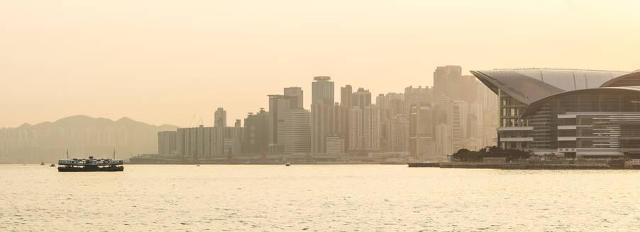 Star Ferry in front of Hong Kong Island at sunset, Hong Kong, China, Asia - RHPLF03579