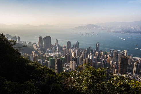 View over Victoria Harbour at sunset, seen from Victoria Peak, Hong Kong Island, Hong Kong, China, Asia - RHPLF03597