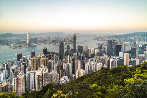 View over Victoria Harbour at sunset, seen from Victoria Peak, Hong Kong Island, Hong Kong, China, Asia - RHPLF03600