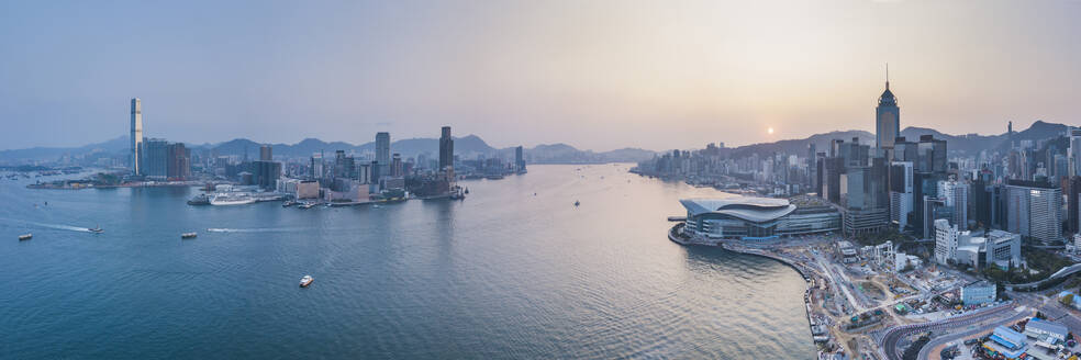 View over Victoria Harbour and Hong Kong at sunset, China, Asia - RHPLF03603
