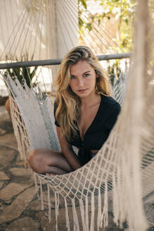 Portrait of a beautiful young woman in a hammock - ACPF00600
