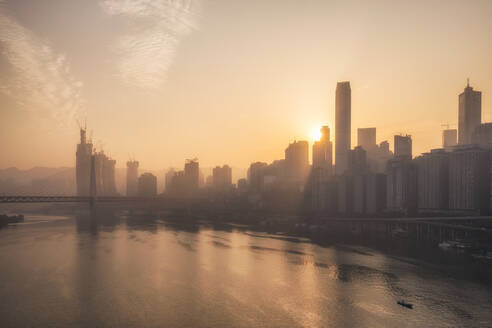 Chongqing city skyline at dawn, with the view of the Yuzhong peninsula CBD and Jialing River, Chongqing, China, Asia - RHPLF04520