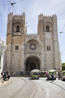 People outside Lisbon Cathedral during sunny day, Portugal - WI03990
