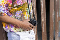 Close-up of man with a camera wearing colorful shirt - AFVF03874