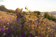 Young woman on meadow at sunset - KNTF03076