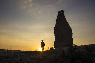 Young woman at sunset, Cappadocia, Turkey - KNTF03088