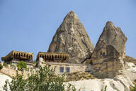 Low angle view of house and rock formation in Göreme city against clear sky, Cappadocia - KNTF03120