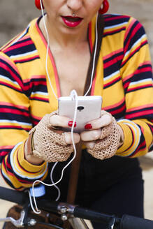 Woman's hands holding smartphone, close-up - RTBF01305
