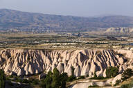 Scenic view of landscape against clear sky during sunny day, Cappadocia, Turkey - KNTF03133