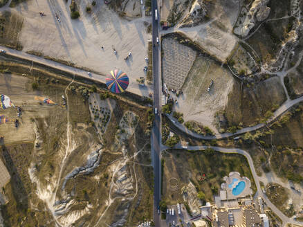 Aerial view of hot air balloon on land at Goreme National Park, Cappadocia, Turkey - KNTF03139