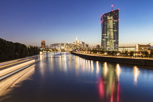 River in illuminated city against blue sky at night in Frankfurt, Germany - WDF05453