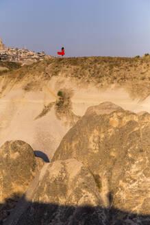 Woman in rocky landscape, Goreme, Cappadocia, Turkey - KNTF03173
