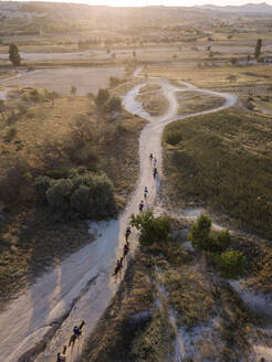 Aerial view of horses on road at Goreme during sunset, Cappadocia, Turkey - KNTF03194