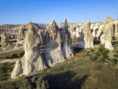 Aerial view of Dove complex monastery against clear blue sky at Goreme National Park, Cappadocia, Turkey - KNTF03203