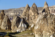 Scenic view of Dove complex monastery against clear blue sky at Goreme, Cappadocia, Turkey - KNTF03206