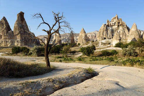Scenic view of Dove complex monastery against clear blue sky, Cappadocia, Turkey - KNTF03209