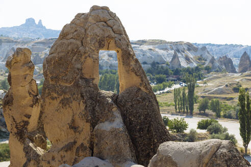 View of rock formations against clear sky at Dove Valley in Goreme, Cappadocia, Turkey - KNTF03212