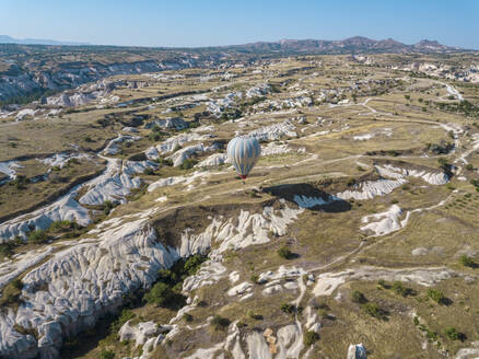 Aerial view of hot air balloon flying at Goreme National Park, Cappadocia, Turkey - KNTF03215