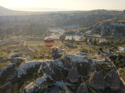 Drone view of hot air balloons flying at Goreme National Park, Cappadocia, Turkey - KNTF03221