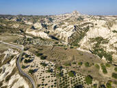Aerial view of landscape against clear blue sky at Uchisar, Cappadocia, Turkey - KNTF03239