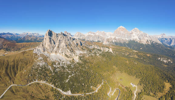 Aerial view of Giau pass and mountains against clear blue sky, Belluno, Italy - WPEF01822