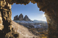 Scenic view of Tre Cime di Lavaredo seen through cave during sunny day, Italy - WPEF01828